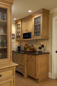Hardwood Floors, tan cabinets, granite countertops, luxurious, elegant, spacious, island, Daniels Design and Remodeling, Kitchen remodel, dark granite, backsplash, pattern, light feel