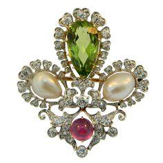 J.E. CALDWELL & CO, Diamond, Natural Pearl, & Burma Ruby Pendant. Stunning, Platinum topped gold, Peridot, Diamond, Burma Ruby, and Natural Pearls brooch/pendant by J.E. Caldwell & Co. Signed and numbered. Late 19th century