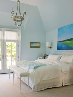 I like the color & the art work behind the bed.  This room looks so cozy.