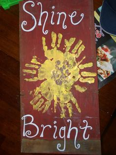 Garden Sign, scrap wood, hand prints, sunflower