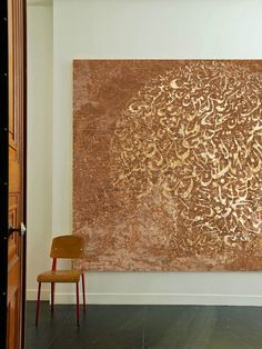 Abstract artwork featuring Arabic calligraphy by Khalid Shahin