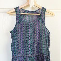 Tribal Print Sleeveless Pleated Peplum Tribal print pleated peplum sleeveless blouse. Sheer chiffon material in perfect condition. American Eagle Outfitters Tops Tank Tops