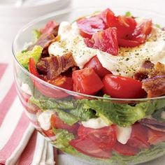 Easy BLT salad - This make-ahead recipe is a favorite side-dish salad for summer potlucks and picnics. Layers of lettuce, tomatoes, bacon, and dressing are stacked in a bowl and kept in the refrigerator until dinner time. Comidas Light, Blt Salad, Great Recipes, Favorite Recipes, Cooking Recipes, Healthy Recipes, Healthy Salads, Summer Salads, Soup And Salad