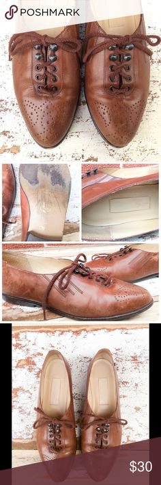Vintage Brown Leather Oxfords, Wingtip Brogue Lovely Etienne Aigner genuine leather oxfords with lace-up hooks and wingtips. These are rare, a super gem of a pair!  Size 8  The insole measures 9 3/4 inches, but this is to the tip and there is a slight point to the shoes. The length of the sole (on the bottom) is 10 1/4 inches. The widest part of the sole measures 3 6/16 inches, narrowest is 2 inches. Heel is 1/2 inch. Vintage Shoes Flats & Loafers
