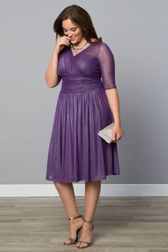 Our plus size Limited Edition Glimmer Cocktail Dress is a great option for a semi-formal wedding with a little sparkle and royal purple color.  Browse our entire made in the USA collection online at www.kiyonna.com.  #KiyonnaPlusYou