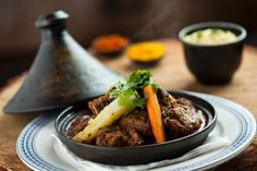 This Lamb Tagine Recipe is courtesy of Moyo. It is slow-cooked with organic apricot jam, cumin, turmeric and paprika. The cumin is not only a symbol of love in some countries; it has been valued since ancient Egypt for its healing properties. It boosts. Lamb Tagine Recipe, Stew, South Africa, Slow Cooker, Moroccan Recipes, Menu, Tasty, Dishes, Travel Goals