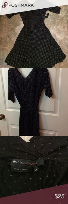 BCBGMAXAZRIA dress Black with tan polka dots and a belted waist, this dress kills!!!! Light weight fabric and a classic pattern BCBGMaxAzria Dresses