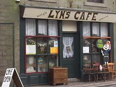 Lyn's Cafe in Bacup is near the centre of town on St James Street It doubles as a secondhand shop. The interior could do with a facelift but the food is good and reasonably priced. Second Hand Shop, Saint James, Liquor Cabinet, Locker Storage, Centre, Drink, Street, Interior, Furniture