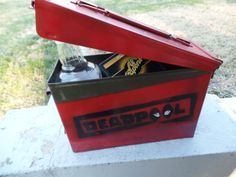 This listing is for a Deadpool themed 30 caliber ammo box. This box is an actual metal ammo box and can be used for storage, display, or as a lunch box. The box will have red, black, and white paint and the graphic will be placed in the same place on all boxes. The box I am selling is pictured above.  Send me a message if you want to order a custom design boxes or sets or if you have questions.  Thanks for shopping