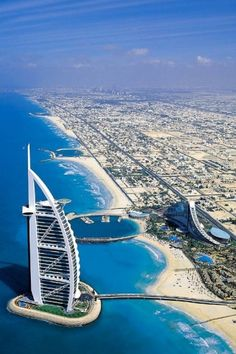 Burj Al Arab, Dubai - the worlds only seven-Star hotel it is the fourth tallest hotel in the world. Burj Al Arab stands on an artificial island near Jumeirah beach and is connected to the mainland by a private curving bridge.