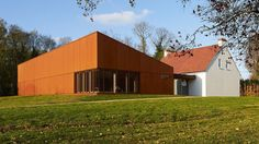 Hugh Broughton Architects has added a new visitor's centre and an oxidised steel-clad extension to the Henry Moore Studios and Garden in Hertfordshire.