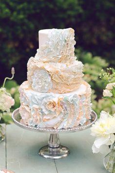 Rustic ruffled, cream and light blue intricate wedding cake. WOW!