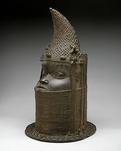 Head of Iyoba  Date:     18th–19th century Geography:     Nigeria, Court of Benin Culture:     Edo peoples Medium:     Brass, iron METROPOLITAN MUSEUM