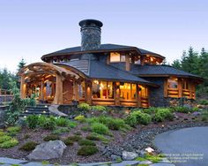 I am fortunate to have a lot of different exterior views of this home. Here is one of my favourites.  For more photos or this or any other or my homes, please check out my website, www.designma.com, my Design Page, www.facebook.com/loghomedesign  #loghomes #loghomedesign #postandbeam #handcraftedloghomes