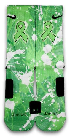 Chances are everyone has a friend or a family member that has gone through cancer. This pair of custom elite socks features splashes of lime green which symbolizes non hodgkin's lymphoma awareness. Please support this cause today and spread the word. For every pair of non hodgkin's lymphoma cancer socks sold, a dollar will be donated to the American Cancer Society.