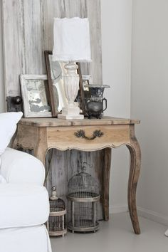 Living Room french wooden side table night stand lamp bird cage photo frames white grey neutral wood
