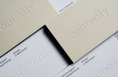 rootedly blind embossed business cards designed by Studio Britz.