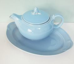 Produced by Taylor Smith & Taylor in the 1940s as part of their highly collectible Lu-Ray Pastels line, this lovely teapot is bathed in a glossy blue glaze...