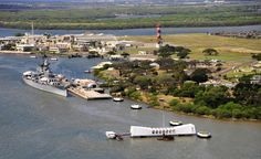 PEARL HARBOR (March 30, 2014) An aerial view of Pearl Harbor showing the Battleship Missouri Memorial, left, Ford Island Field Control Tower, center, and the USS Arizona Memorial, right. (U.S. Navy Photo by Mass Communication Specialist 1st Class Daniel Barker/Released)
