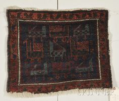 Northeast Persia, last quarter 19th century, (some end fraying, selvage damage), 2 ft. 2 in. x 1 ft. 8 in. Estimate $600-800 Sold for: $948