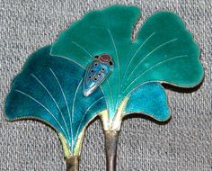 Sterling cloisonne enamel art nouveau hair pin depicts two Gingko leaves with a bug.