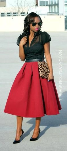 black blouse, maroon flare full midi skirt, black heels