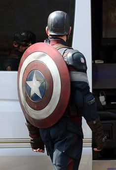 Chris Evans on the AVENGERS: AGE OF ULTRON set in the new Captain America costume.
