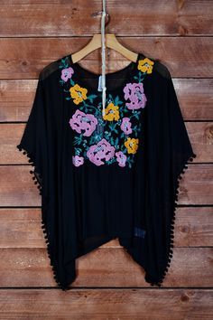 Harper - Nobella Grace Boutique! Gorgeous top with poms and embroidered details! Would be gorgeous with skinny jeans or shorts. #nobellagrace #spring2015 #poms