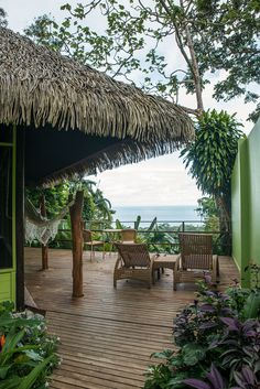Relax on the balcony of your private bungalow overlooking the rainforest and ocean at Lapa Rios