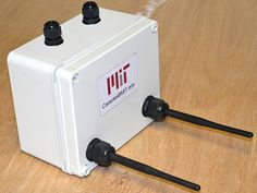 A small off-white plastic box with two protruding black antennas