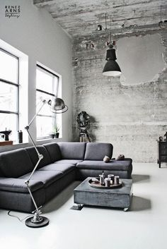 Industrial chic loft living area space room.  Love the brick walls