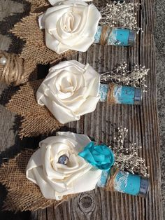 Light teal blue burlap and shotgun shell boutonnieres with handmade silk flower~Don't forget personalized napkins to match your color scheme! #country www.napkinspersonalized.com
