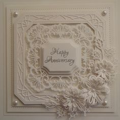 Hi Bloggers.   Here's today's card -     All Coconut White Card  on this one.   I started with the frame. I cut the outer die in Sue Wilson'...