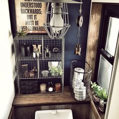 Industrial style - metal, inky blue wall paint, light colored wood