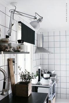 Swing arm lamp in the kitchen. //Caisa K