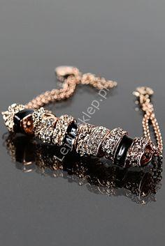 Bracelet with crystals. Bransoletka z cyrkoniami w kolorze miedzi