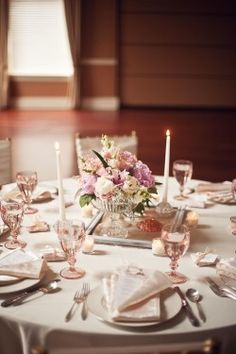 Check out this page too- it shows a lot of different ideas for centerpieces using your basic color scheme with all the lace and glass. A lot of if them have a really nice vintage/romantic look ( I know some are a little too old school- but just to give you some ideas)