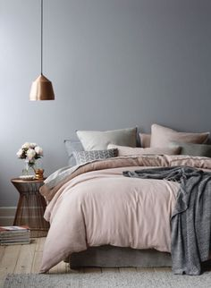 Neutral Palette Bedroom Ideas. Copper Accent Lamp with neutral color bedding.
