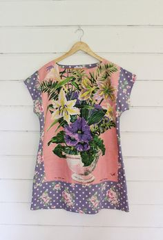 This pretty floral tunic was designed around an upcycled linen tea towel. Love that idea and love the matching purple fabric! | design by apieceofpie