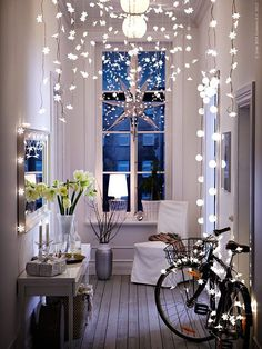 Creative Ways to Use String & Twinkle Lights | Drape these bright strands anywhere that needs a little holiday cheer, and maybe leave them up for the rest of the season to fight the winter blues.