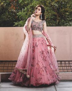 You can be assured to make a great style statement with this pink floral print organza lehenga. This lehenga is enhanced with fancyprint and lace border work .Buy this latest designer lehenga choli online .Paired with matching choli and dupatta Indian Gowns Dresses, Indian Fashion Dresses, Dress Indian Style, Indian Designer Outfits, Indian Wedding Dresses, Maxi Dresses, Saree Fashion, Indian Weddings, Pakistani Dresses
