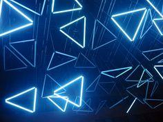Watch an Epic Light Installation That Dangles From the Ceiling | They form 50 motorized LED triangles. Image: Andrea Aubert   | WIRED.com