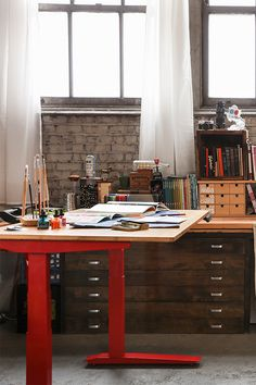 Great stylish home office inspiration - we dig this red desk. I #WorkingInStyle