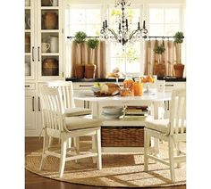 Obsessed with white kitchen tables. and this one has shelving under! Shayne Drop-Leaf Kitchen Table | Pottery Barn