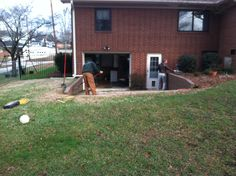 Before pic. Timber wall and turf area