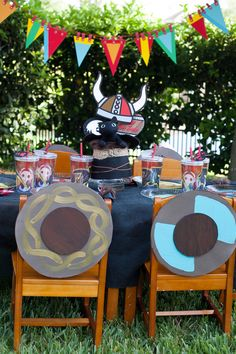 Flag banner and hanging viking hat over table