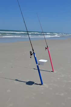 Beach and Surf fishing rod holder augers easily into the sand and can be used in the water. Optional bait and tackle table tilts for your desired angle! AugHog! #fishingrods