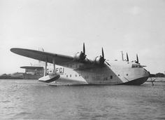 The first of the Short S.26 Grenadier (or: 'G-') Class flying boats 'Golden Hind' G-AFCI being converted to military markings in September 1939. Seen here on the River Medway near Rochester in Kent.