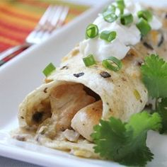 Chicken Enchiladas II - our families favorite on Allrecipes.com - we double the sauce, add onions, and use corn tortillas.