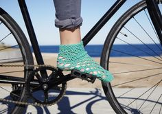 Crocheted. Glow-in-the-dark. Bike fashion. Culture Cycle is a seriously kooky range of handmade crocheted bits and pieces, intertwined with reflective yarns that light up at night.